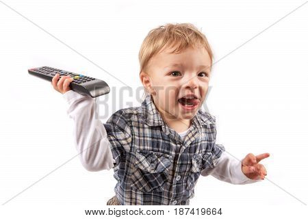 Funny baby boy got the TV remote control. Isolated on white.