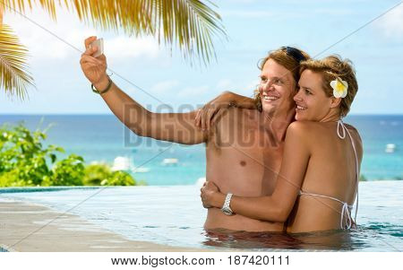 Young couple on vacation taking selfie romantic summer