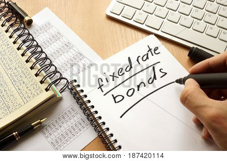Fixed rate bonds written in a note. Trading concept.