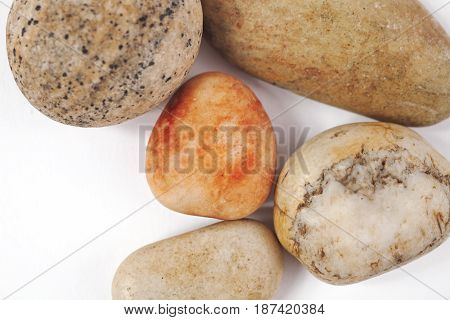 Five natural stones on a white background