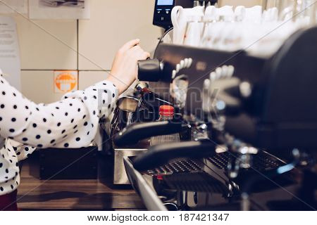 Woman Foaming Milk For Cappuccino