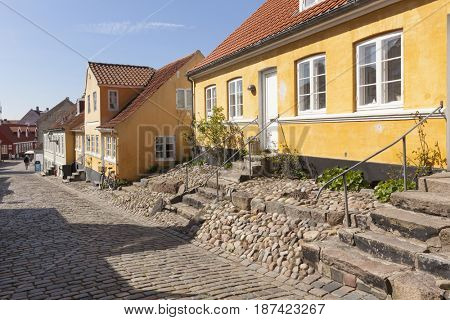 Ebeltoft, Denmark - May 1, 2017: Street through the old town of Ebeltoft. It is located in Syddjurs municipality in Region Midtjylland on the larger Djursland peninsula of Jutland.