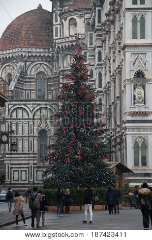 Italy Florence -December 25 2016: the view of New Year Tree on Piazza del Duomo Duomo Santa Maria del Fiore and Baptistery of Saint John on December 25 2016 in Florence Italy.