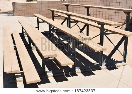 Bleachers in a park in Phoenix. Old dirty wooden bleachers.