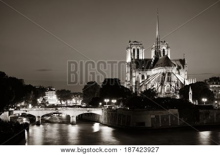Notre Dame de Paris at dusk over River Seine as the famous city landmark.