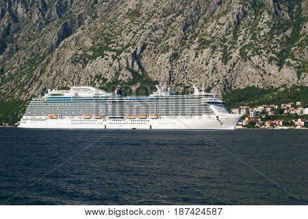 Luxury cruise ship near the mountain coast