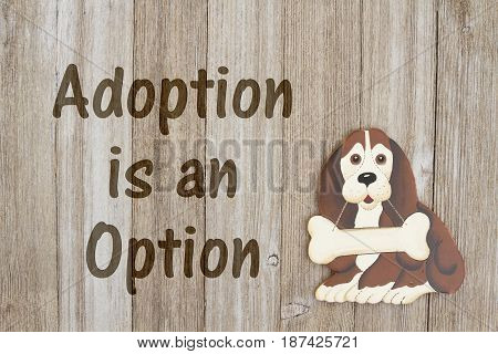 Rescuing a dog A wood dog with a bone on a weathered wood background with text Adoption is an Option