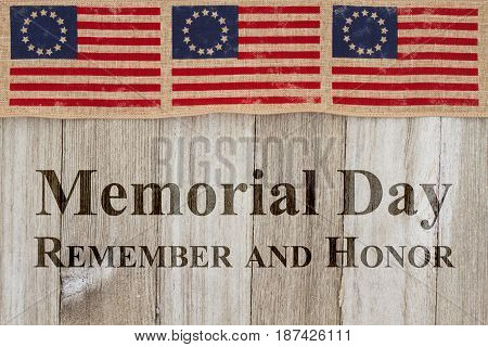 Memorial Day greeting USA patriotic old Betsy Ross flag and weathered wood background with text Memorial Day Remember and Honor