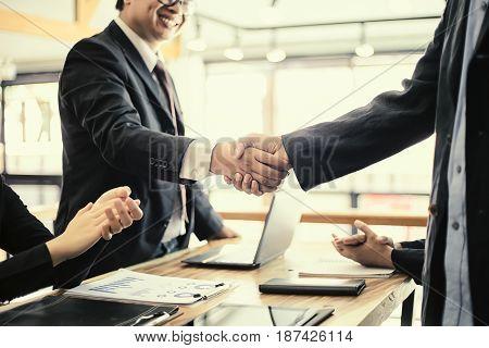 Business partnership handshake successful Business success concept soft focus vintage tone