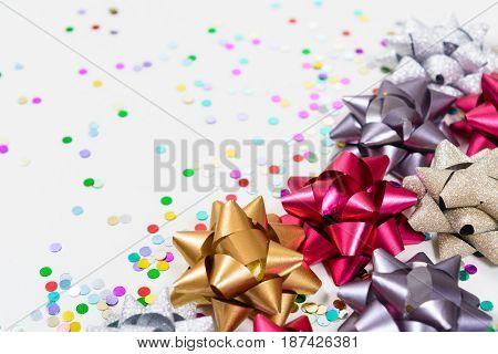 Macro Festive Bows With Confetti