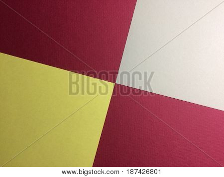Abstract geometric paper composition. Yellow and grey sheets on red background.