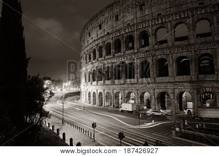 Colosseum at night with light trail in Rome, Italy.