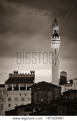 Medieval town Siena skyline view with Bell Tower and historic buildings in Italy at night