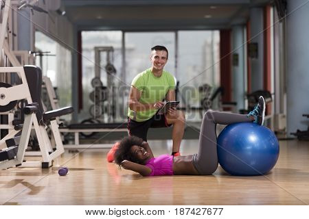 healthy young couple exercise in gym pilates  workout with personal trainer