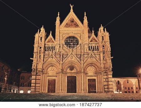 Siena Cathedral closeup as the famous landmark in medieval town at night in Italy.