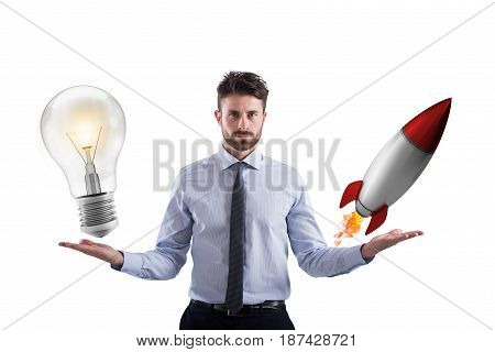 Businessman compares a lightbulb to a rocket. concept od idea and start-up