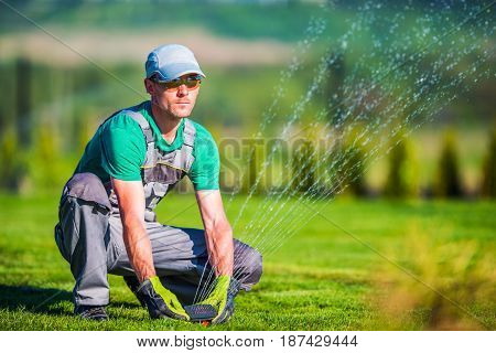 Gardening Systems Technician Worker. Professional Gardener Testing Automatic Watering System.