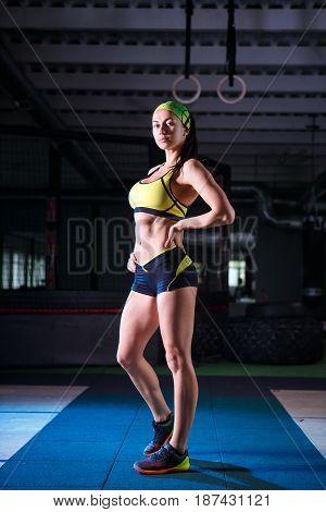 Beautiful, Strong, Slender, In Good Physical Shape In The Gym Doing Exercises. Dressed In Short Shor
