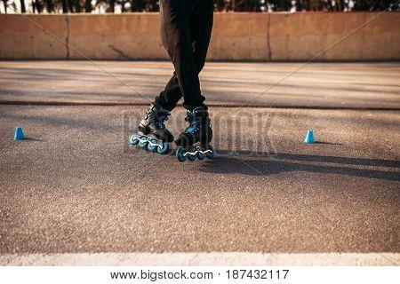 Roller skater legs in skates, balance exercise