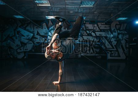 Breakdance performer posing in dance studio