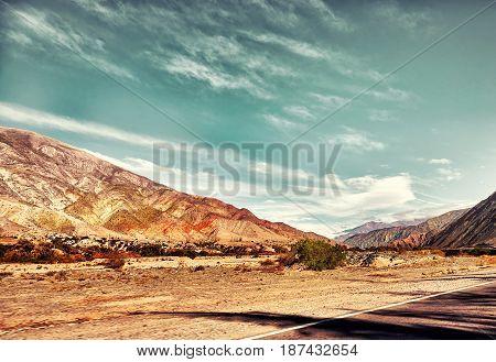 Cerro del los Siete Colores. Coloured mountains. Hill of Seven Colors over Purmamarca village. Quebrada de Humahuaca valley, a UNESCO World Heritage Site, Argentina