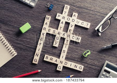 Marketing and business concept with crossword collected of game blocks