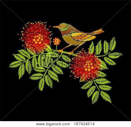 Embroidery Japanese Robin bird sitting on the branch with red blossom flowers isolated on black background.
