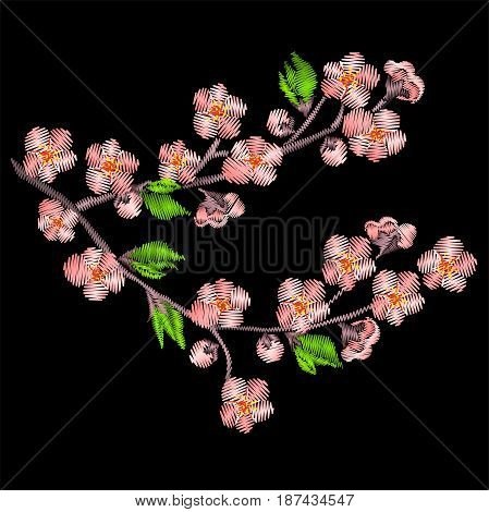 Pink embroidery Japanese sakura branch isolated on black background.