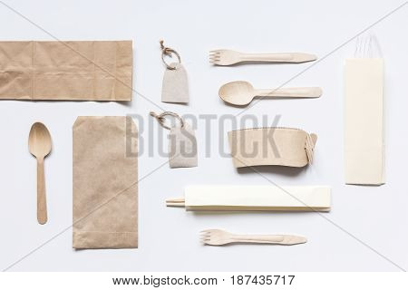 breakfast take away with paper bags on white restourant table background top view mock up