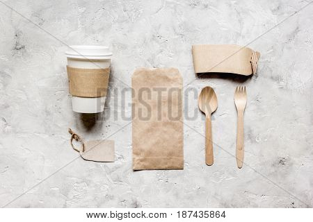 breakfast take away with paper bags on gray restourant table background top view mock up