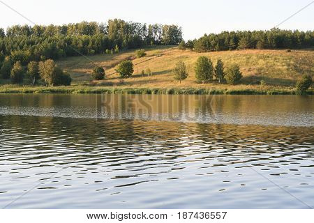 Beautiful scenery, river bank. Ripples and waves on the water