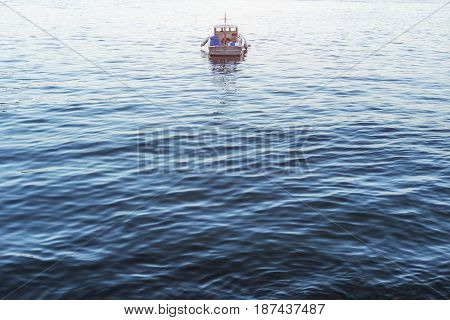 Sailing boat on blue sea, conceptual image