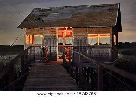 Swampland walkway with hut (Lake Tisza, Hungary)