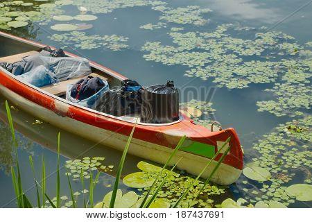 Canoe on the riverside full of camping equipment