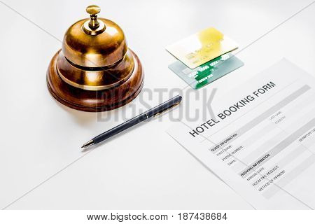booking form for hotel room reservation on white table background