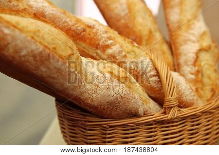 fresh baguette in a wicker basket on the table
