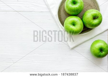 summer food with green apples on white table background top view mock up