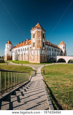 Mir, Belarus. View Of Old Towers Of Mir Castle Complex On Blue Sunny Sky Background. Architectural Ensemble Of Feudalism, Ancient Cultural Monument, UNESCO Heritage. Famous Landmark In Summer