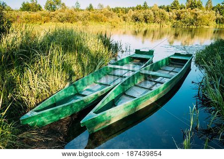 Lake Or River And Two Old Wooden Blue Rowing Fishing Boats At Beautiful Summer Sunny Day Or Evening.