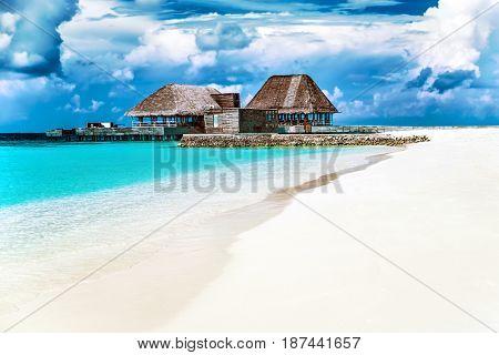 Beautiful little villa on the perfect white sand, peaceful summer vacation on the luxury beach resort, Maldives island