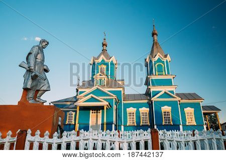 Krasnyy Partizan, Dobrush District, Gomel Region, Belarus. Monument To Heroes Who Died In Battles For Liberation Of Gomel Region At Great Patriotic War, Old Orthodox Church Of Nativity Of Virgin Mary poster