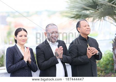 ornchanok Mabklang, Panya Yimumphai and Vithaya Pansringarm attend the 'A Prayer Before Dawn' photocall during the 70th Cannes Film Festival at Palais des Festivals on May 19, 2017 in Cannes, France.