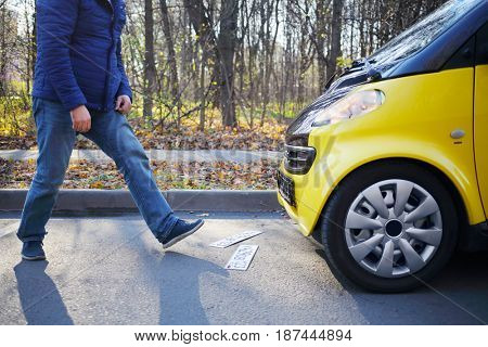 MOSCOW - OCT 25, 2016: Male legs, numbers of car, Mercedes Smart (model with release) in Sokolniki where conducted Auto Show - Oldtimer, Gallery