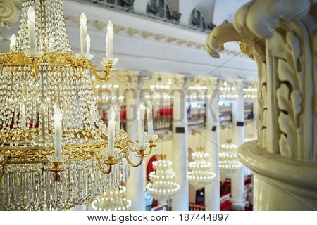 MOSCOW, RUSSIA - APR 23, 2016: Closeup chandelier with electrical candles in the hall of Union House during A Just Russia political party meeting at 8th congress.