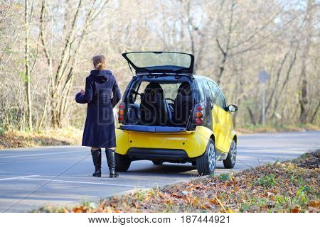 MOSCOW - OCT 25, 2016: Woman (with model release) stands near Mercedes Smart in Sokolniki where conducted Auto Show - Oldtimer, Gallery