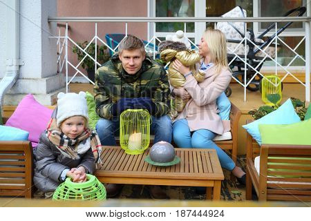MOSCOW - OCT 25, 2016: Girl, mother, baby and father (with MR) at terrace in summer residence of Mosdachtrest company, which manages summer houses fund, services and rents out-of-town property