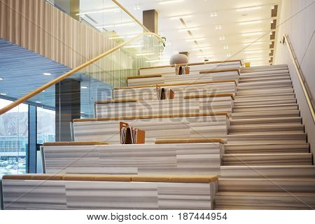 MOSCOW - APR 16, 2016: Stairs with seats and magazines in Hyundai Motorstudio. Hyundai produces not only cars, but also its own collection of furniture and household items
