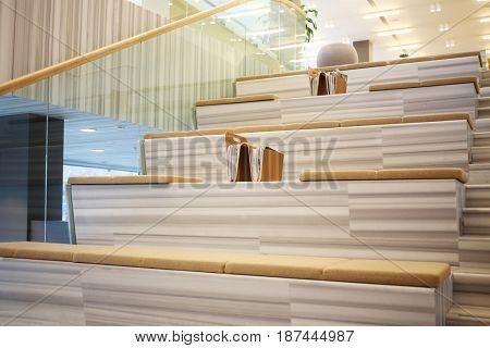 MOSCOW - APR 16, 2016: Stairs with soft sitting places and magazines in Hyundai Motorstudio. Hyundai produces not only cars, but also its own collection of furniture and household items