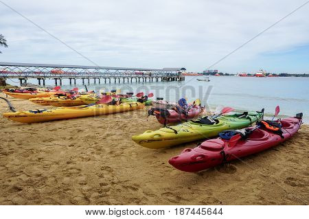 Labuan,Malaysia-Feb 19,2017:Kayaks in various colors in Labuan island,Malaysia.Malaysia is the ideal place for water sports,like white water rafting,kayaking,scuba diving & sailing.