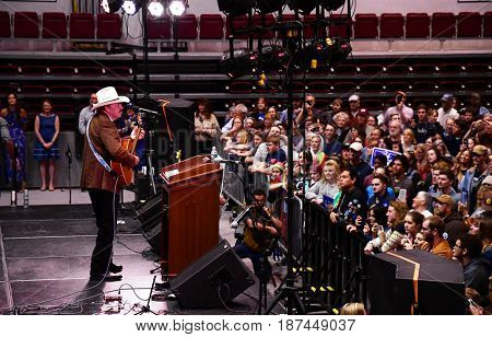 MISSOULA, MONTANA, USA - May 20, 2017: US House of Representatives candidate Rob Quist  plays guitar for supporters at a 2017 Montana special election rally at University of Montana